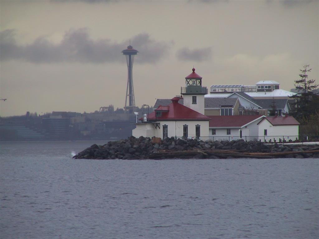 Quartermaster harbor vashon island leaving elliott bay on a drizzly april evening a gloomy looking downtown seattle was visible behind the alki point lighthouse nvjuhfo Choice Image
